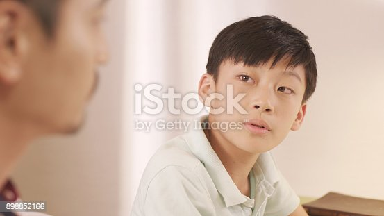 istock Asian father talking & counseling his frustrated teenage boy at home 898852166