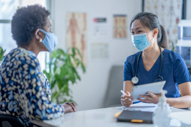 Asian Female doctor meeting patient stock photo