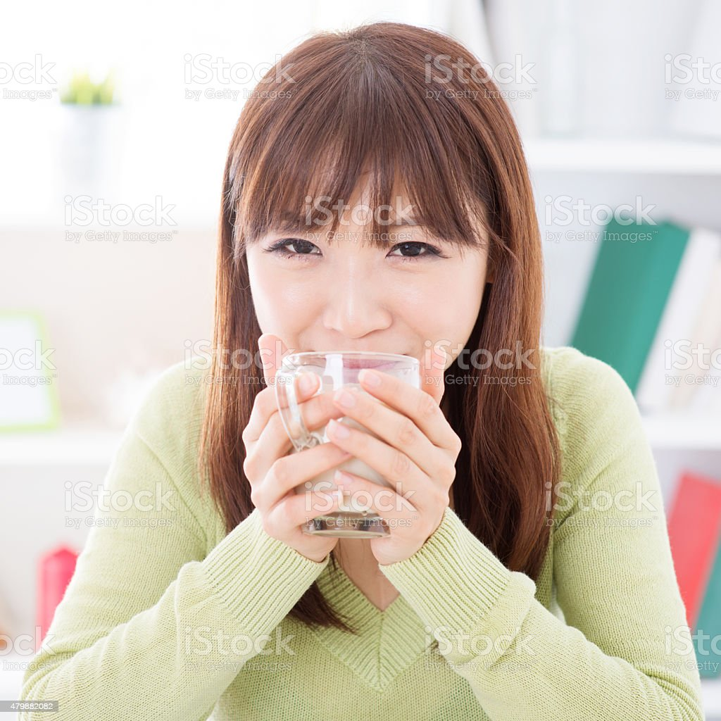 Asian female drinking soymilk stock photo