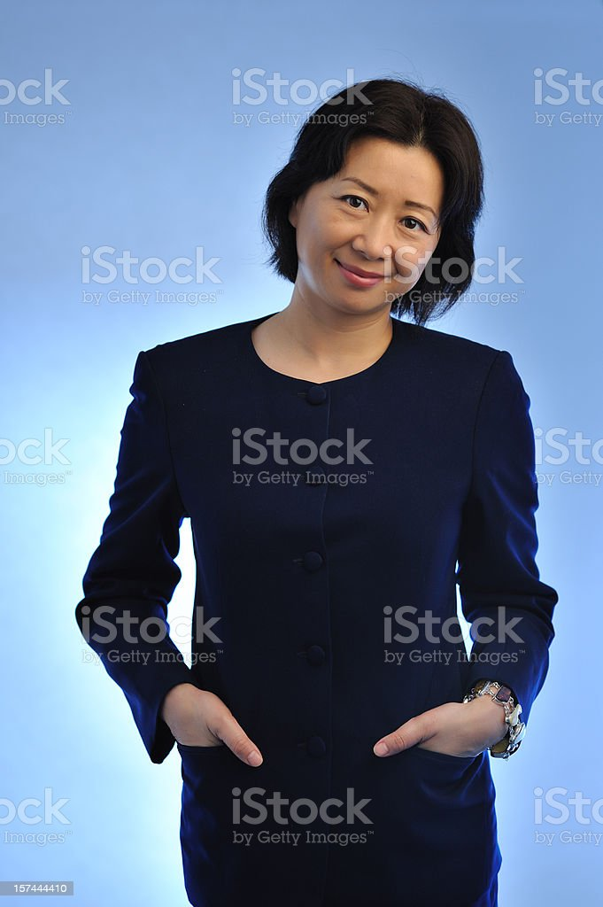 Asian female executive in blue royalty-free stock photo