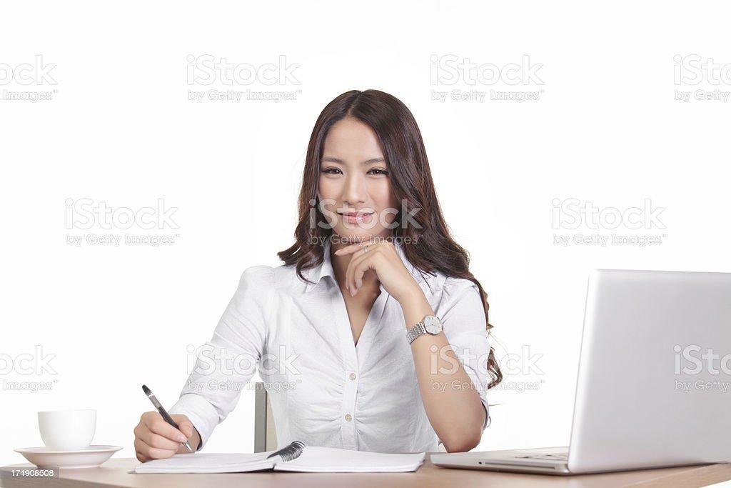 asian Female Executive Working On Laptop - Isolated royalty-free stock photo