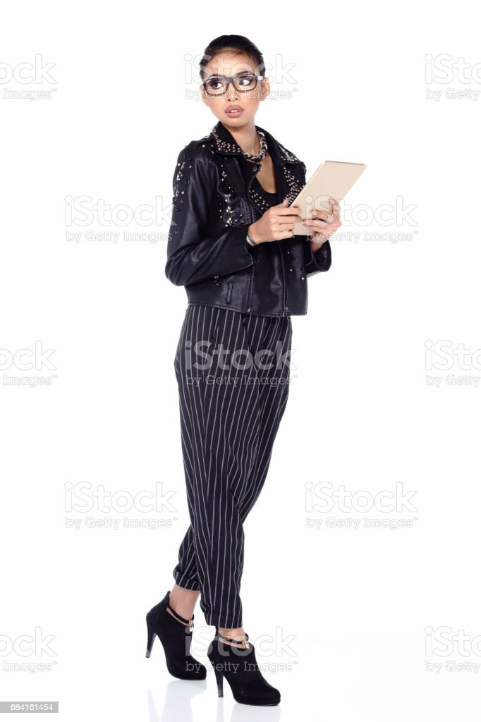 Asian Female Fashion Designer draw and paint on tablet royalty-free stock photo
