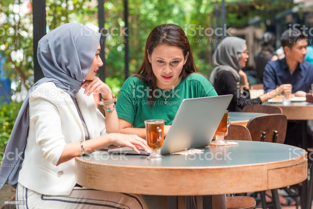 Asian female friends in cafe royalty-free stock photo