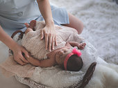 istock Asian female newborn baby lying in bed and sunlight in the morning. Cute little girl  three weeks old. Health, care, love, relationship concept. 1138322716
