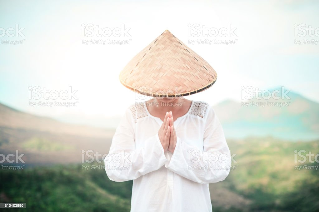 Asian Female Praying Near the Volcano Mountain stock photo
