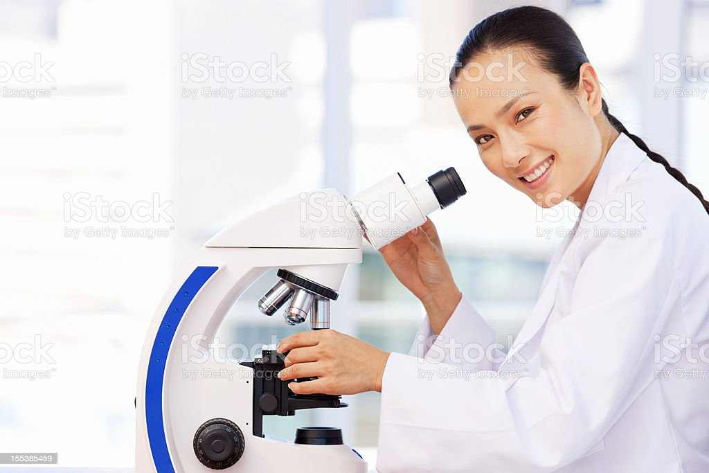 Asian Female Researcher Working In Laboratory stock photo