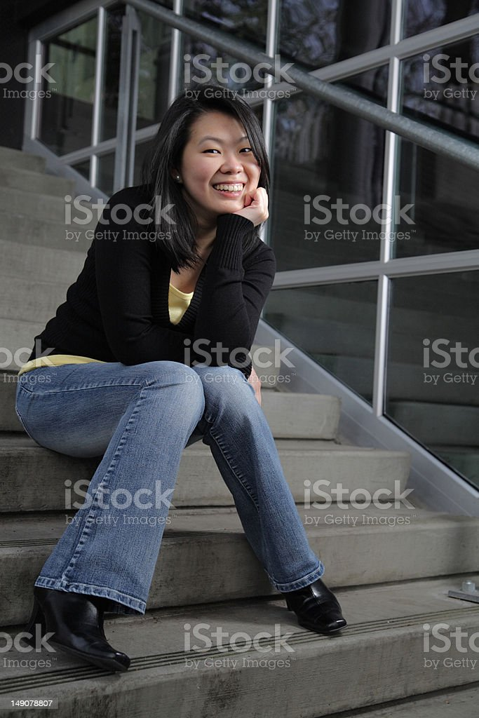 Asian female sitting on a steps stock photo