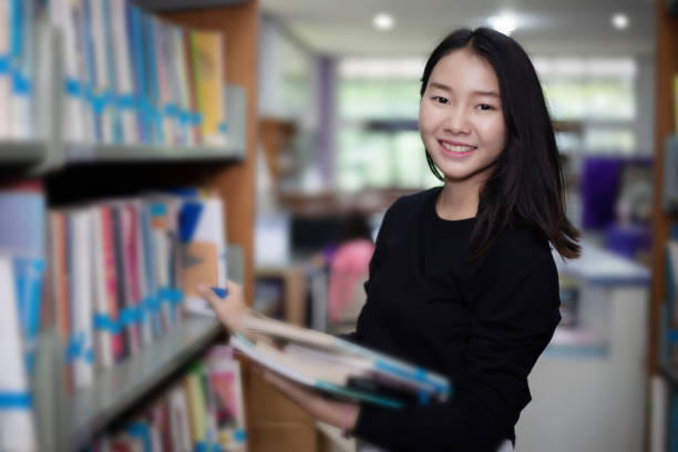 Asian female students holding for selection book in library picture id994382514?b=1&k=6&m=994382514&s=612x612&w=0&h=cfkgl2rzsaikn7h0459rkqd2p3hmiqquqgximnpmv k=