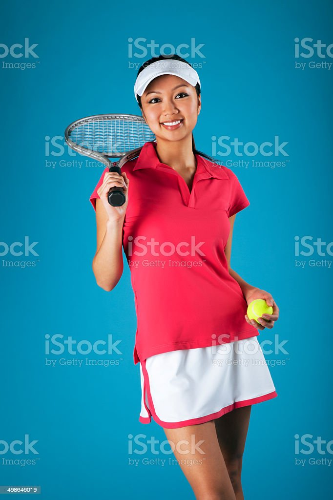 Asian Female Tennis Player on Blue stock photo