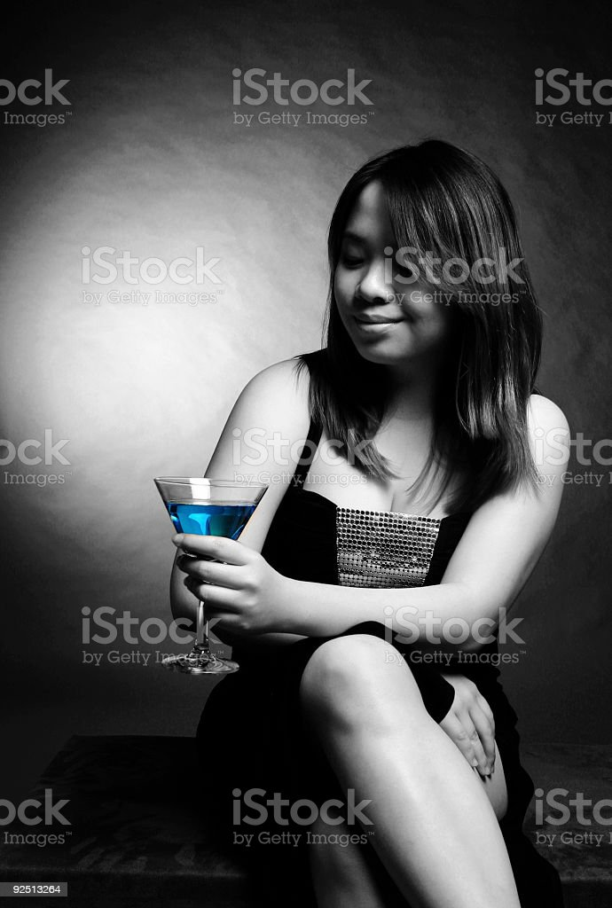 Asian female with cocktail royalty-free stock photo