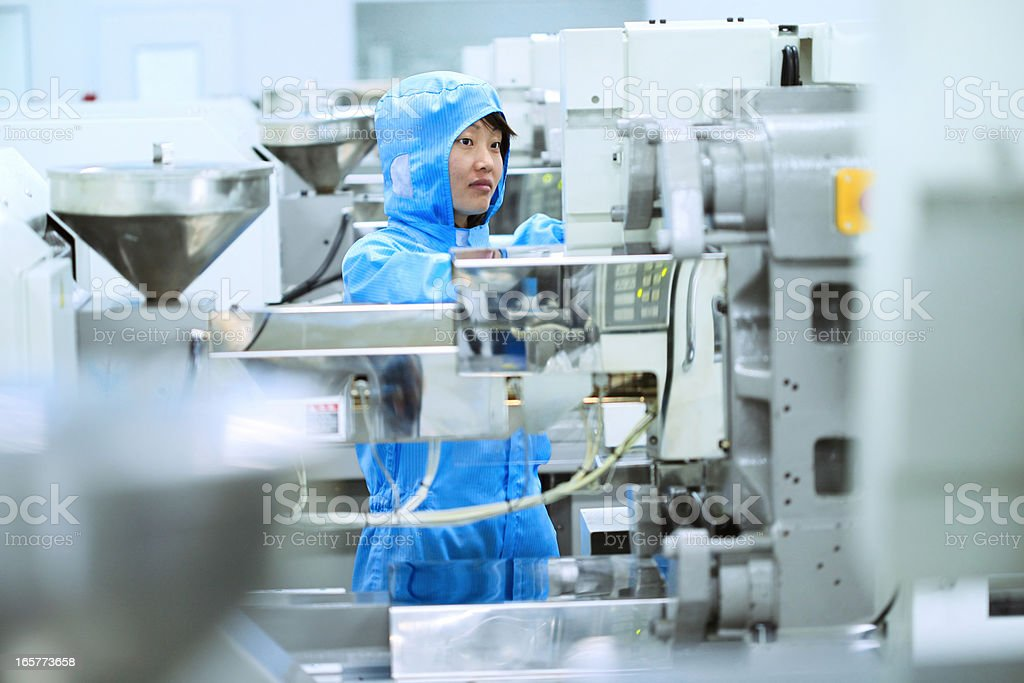 Asian female with factory machine stock photo