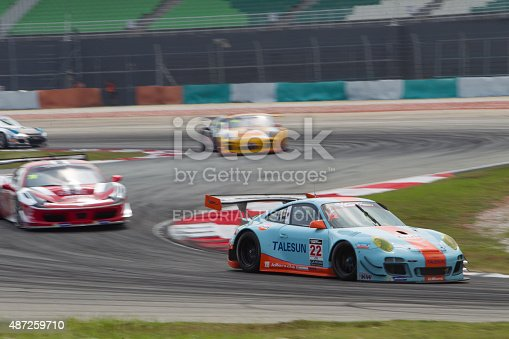 Sepang, Malaysia - September 5, 2015: German Porsche car no 22 exits turn 2 at Asian Festival of Speed Race, Sepang, Malaysia