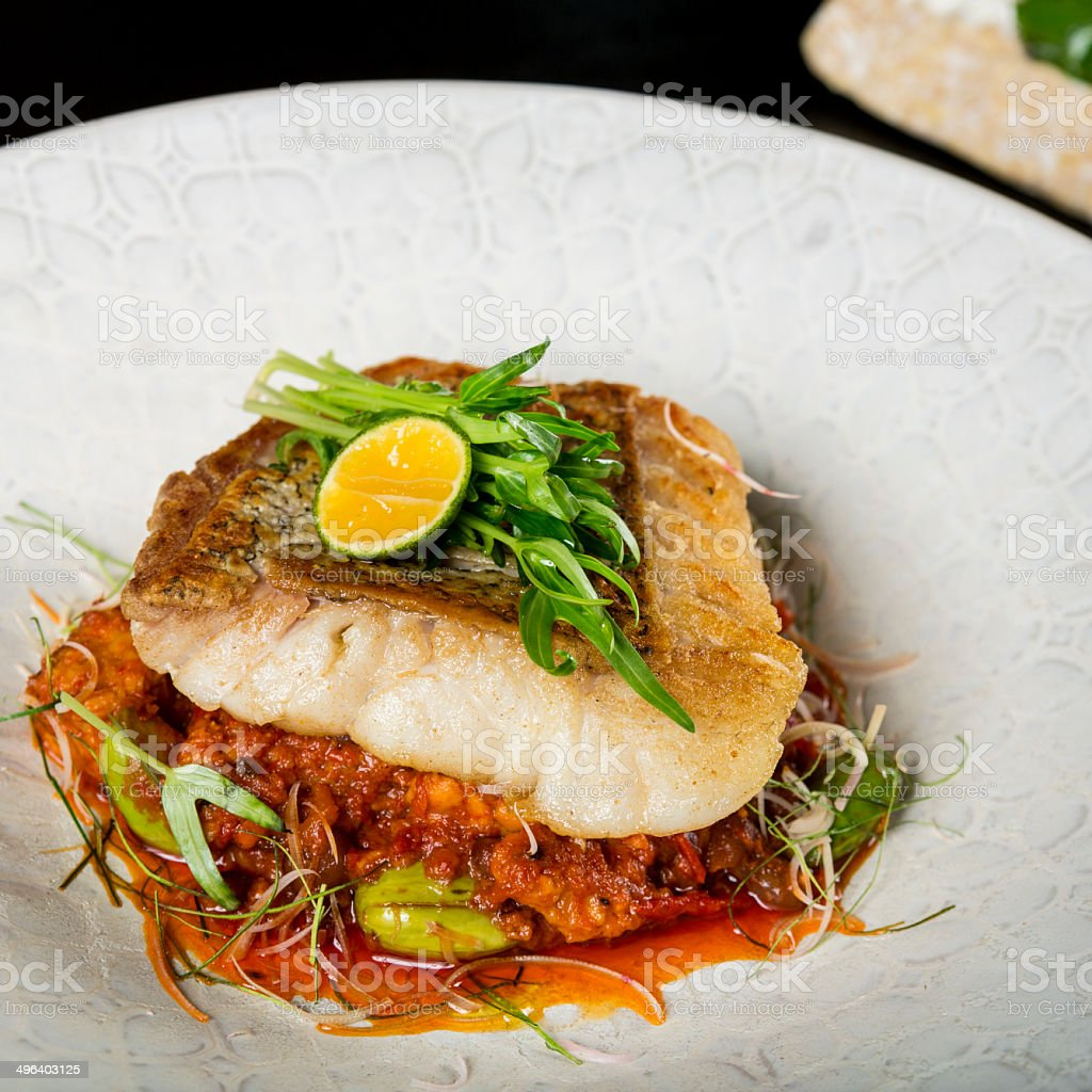 Asian fish fillet with tempeh stock photo