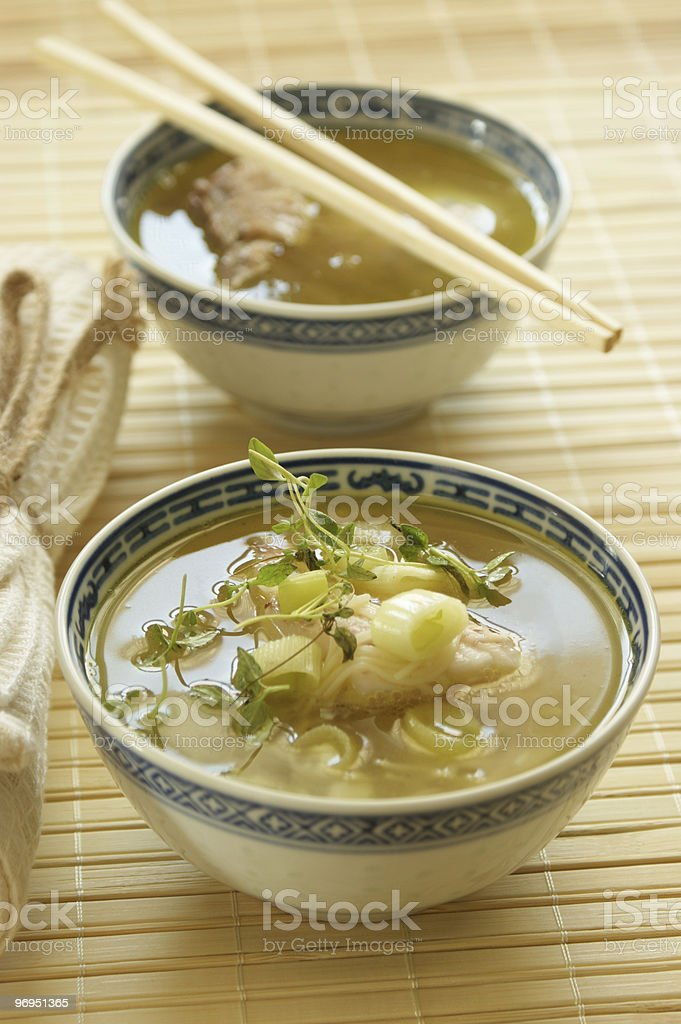 asian fish soup with noodle and herbs royalty-free stock photo