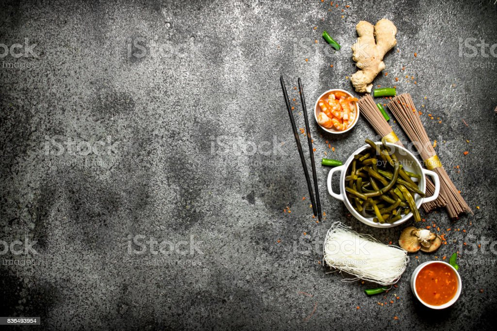Asian food a variety of ingredients for cooking chinese or thai food asian food a variety of ingredients for cooking chinese or thai food on a rustic forumfinder Images