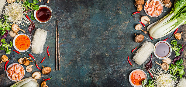 Asian food background with various of cooking ingredients Asian food background with various of cooking ingredients on rustic background , top view , banner.  Asian food concept: Chinese or Thai cuisine. rice noodles stock pictures, royalty-free photos & images