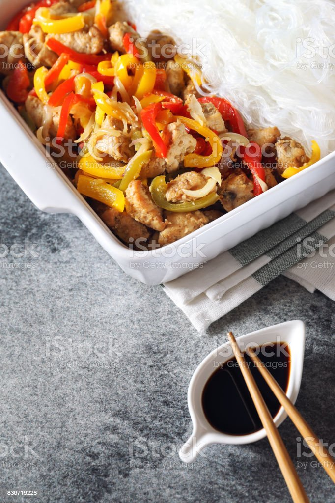 Asian food: Fried chicken with tricolor bell peppers stock photo