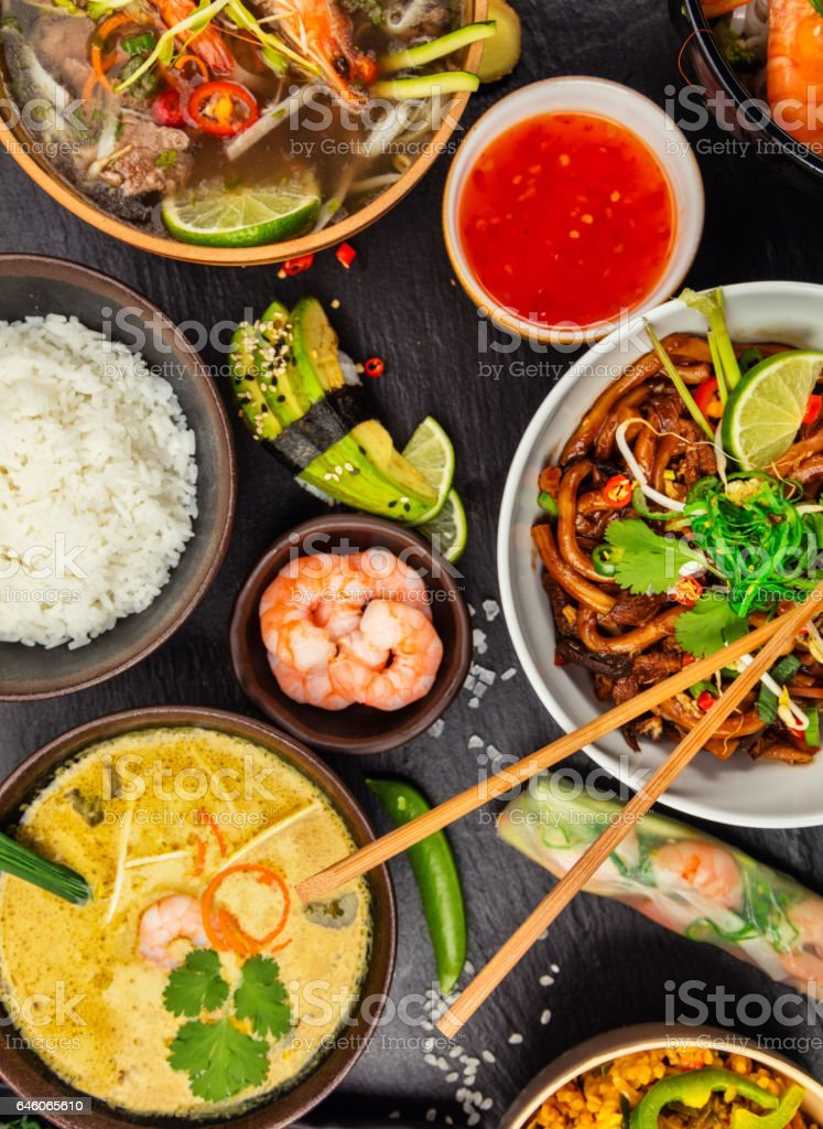 Asian food served on black stone, top view stock photo