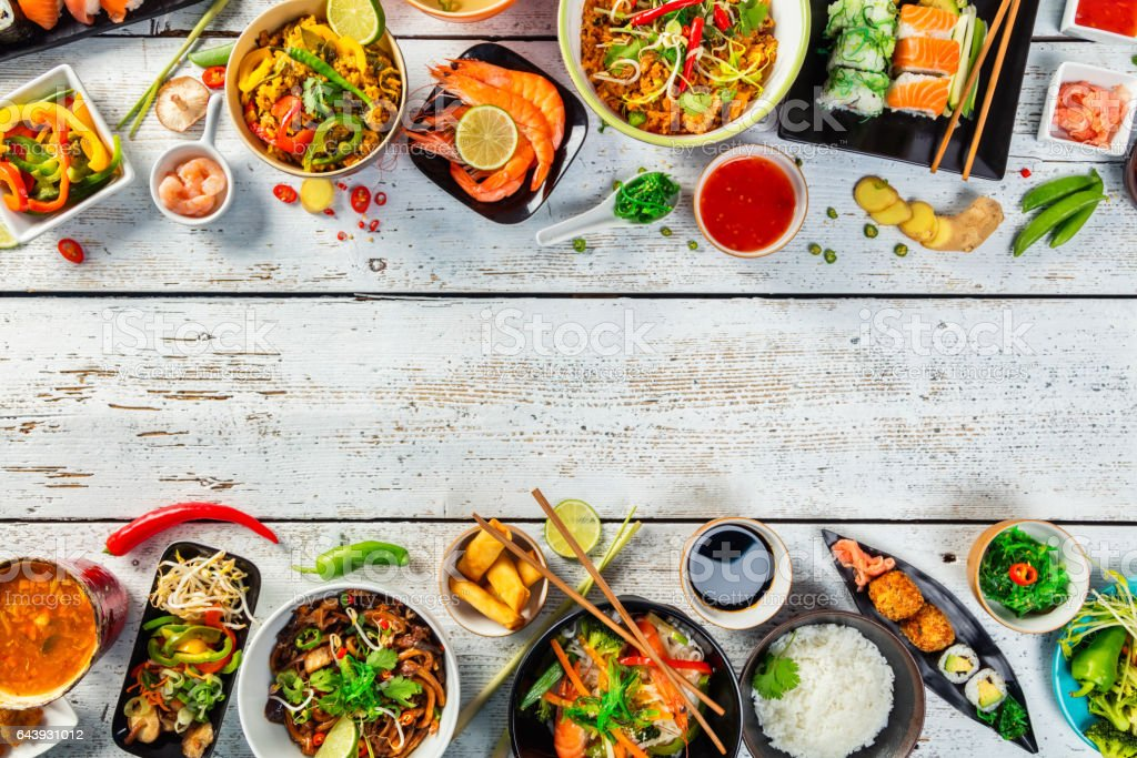 Asian food served on wooden table stock photo