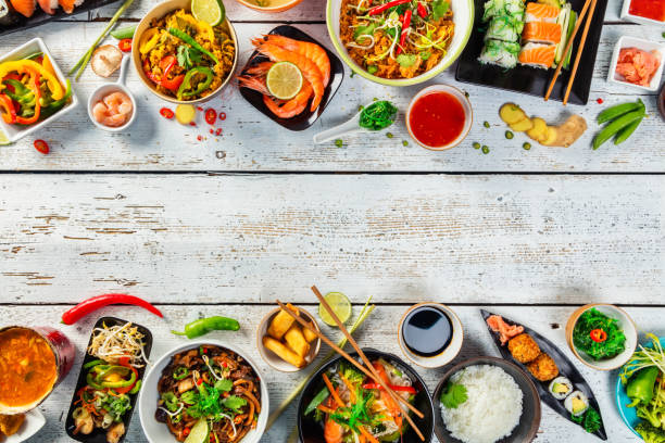 asian food served on wooden table - chinese food stock photos and pictures