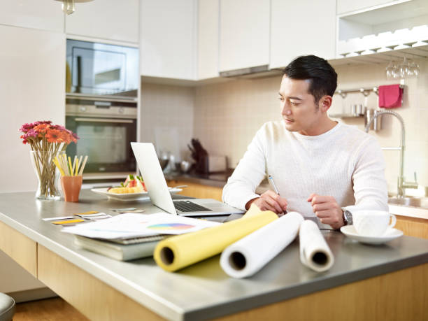 asian freelance designer working from home stock photo