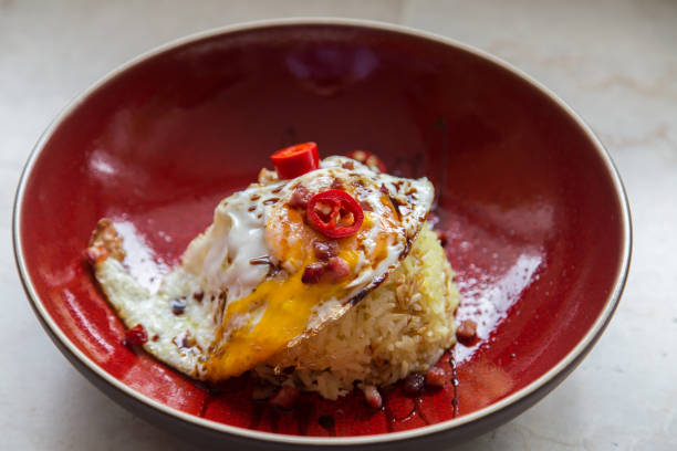 Asian fried egg with chilli and rice stock photo