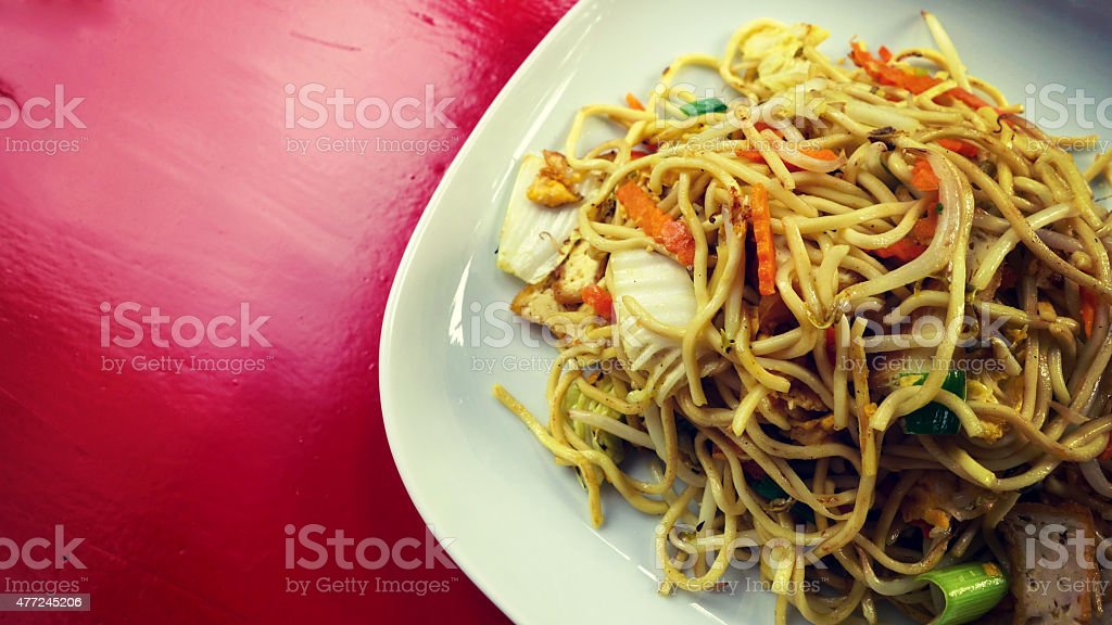 Asian fried noodles with tofu stock photo