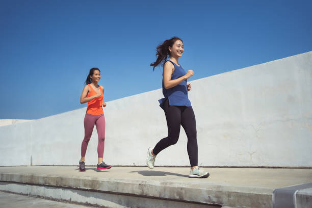 Asian friends group jogging in the morning stock photo