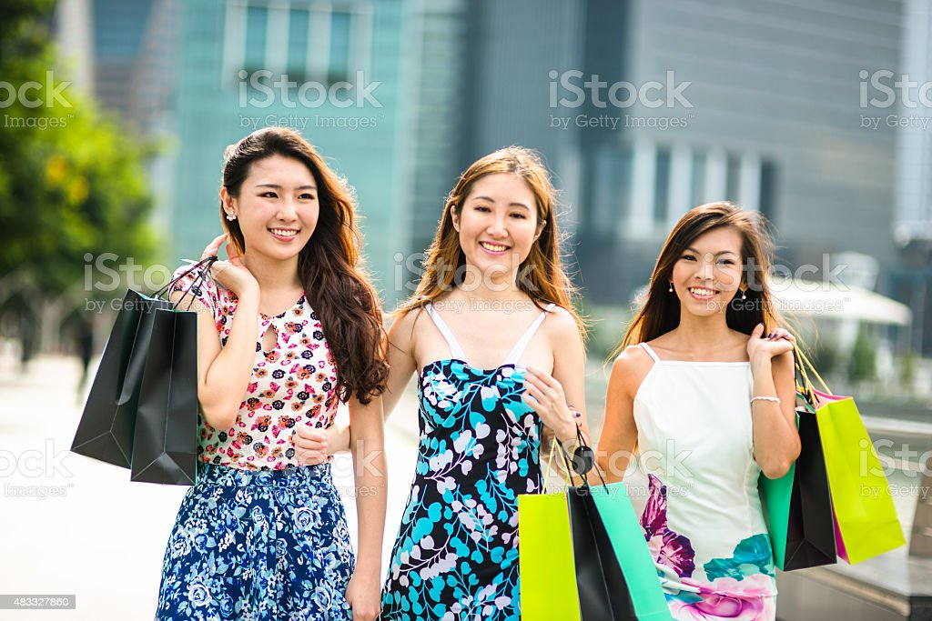 Asian friends potrait with the shopping bag on the city