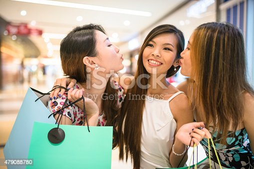 Asian friends shopping in the mall