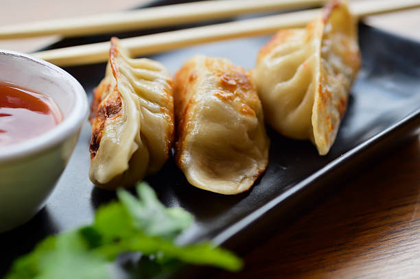 asian fusion - dumplings stock photos and pictures
