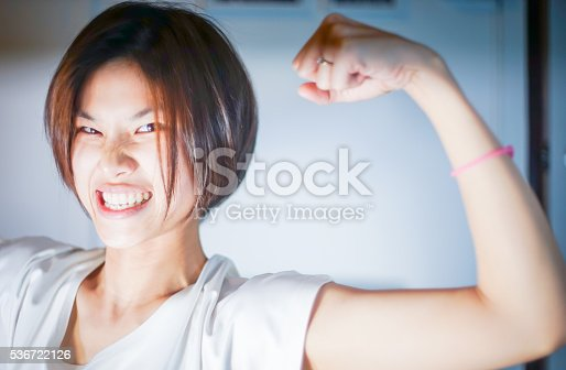istock Asian Girl Acting Strong with Muscle 536722126