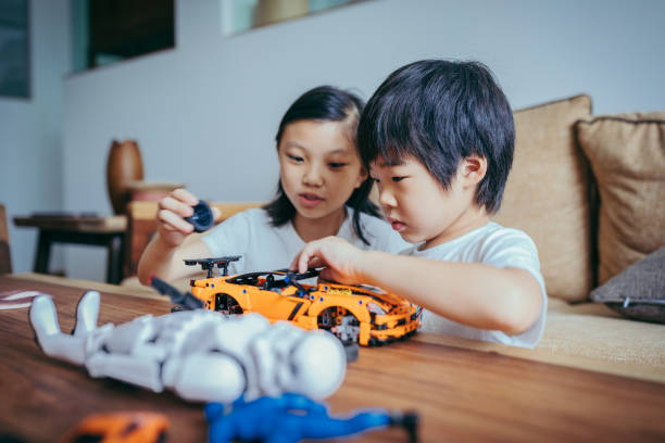 asian girl and boy playing together at home. - two students together asian foto e immagini stock