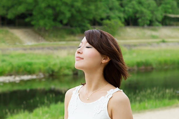 asian girl beside river. breath and relax - beautiful curvy girls stock photos and pictures