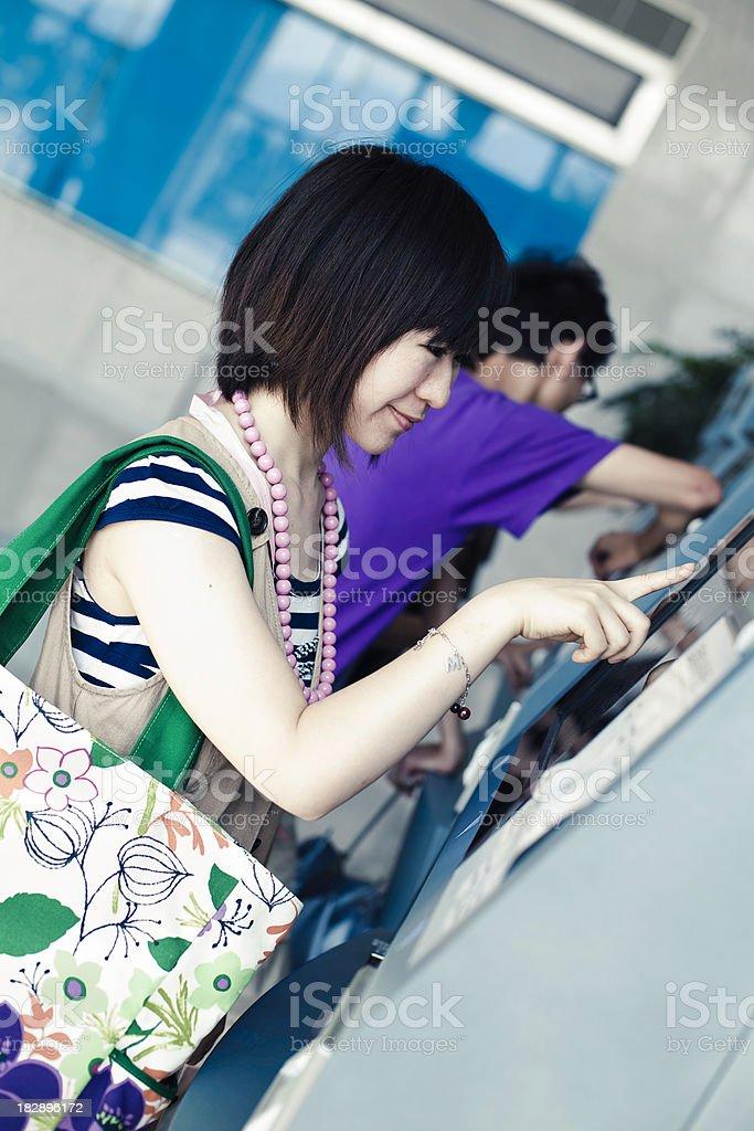asian girl buy ticket royalty-free stock photo