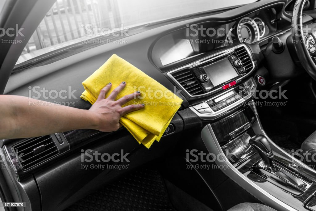 Asian girl Clean console modern car, black indoor design, copy space. stock photo