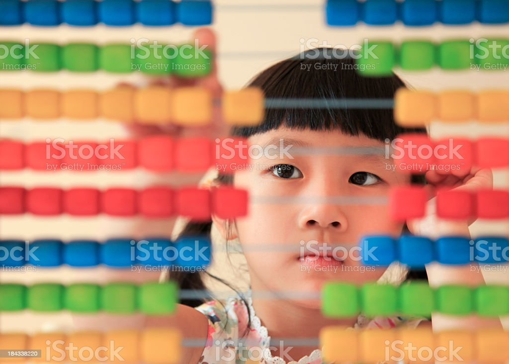 Asian Girl Counting with Abacus stock photo