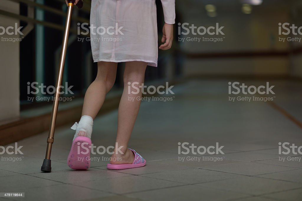 Asian girl Cruches And Cast At injuried Leg stock photo