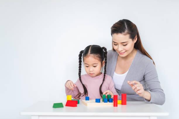 Asian girl daughter playing blocks toy with mother over white happy picture id1072338914?b=1&k=6&m=1072338914&s=612x612&w=0&h=z8tyofrci32 qbljlvrmnujviqhrjbsxjekvivd4 py=