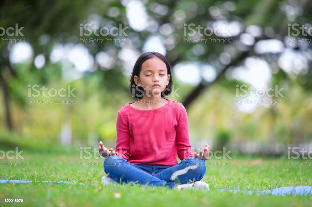 asian girl doing yoga pose in the park outdoor stock photo