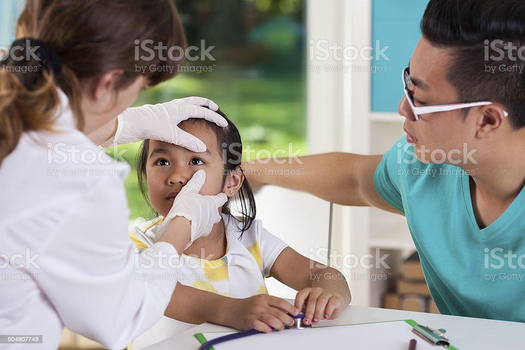 Asian girl during eye examination stock photo
