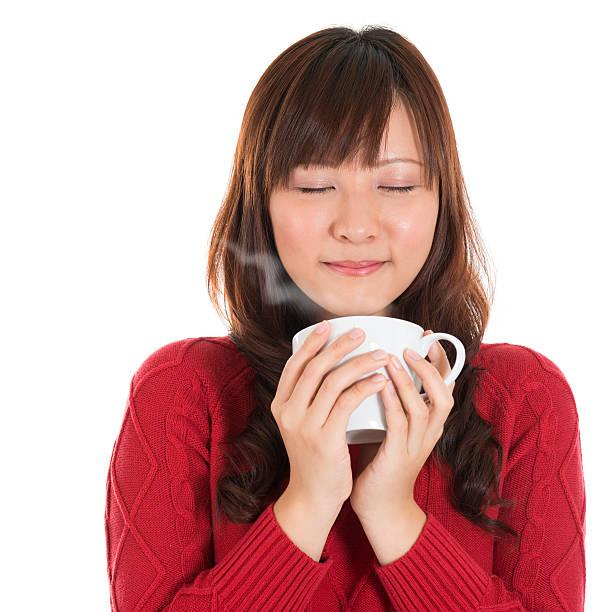 asian girl enjoying coffee - food woman to smell bildbanksfoton och bilder
