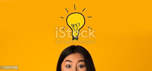 1162297213 istock photo Asian girl head with idea bulb above 1161374100