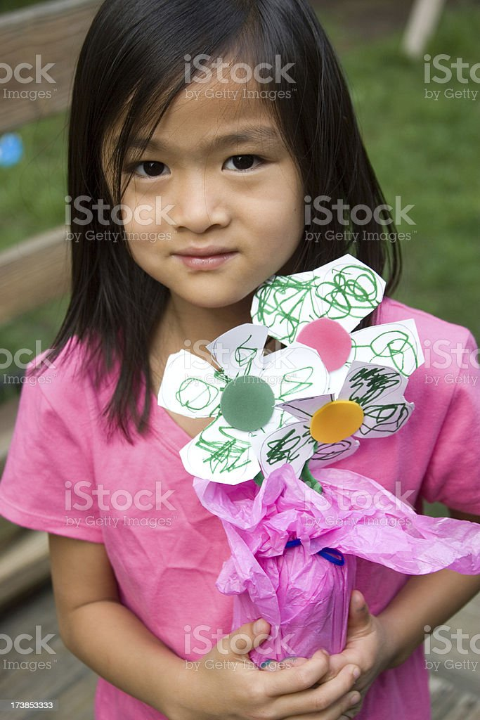 Asian girl holding hand-made flowers royalty-free stock photo