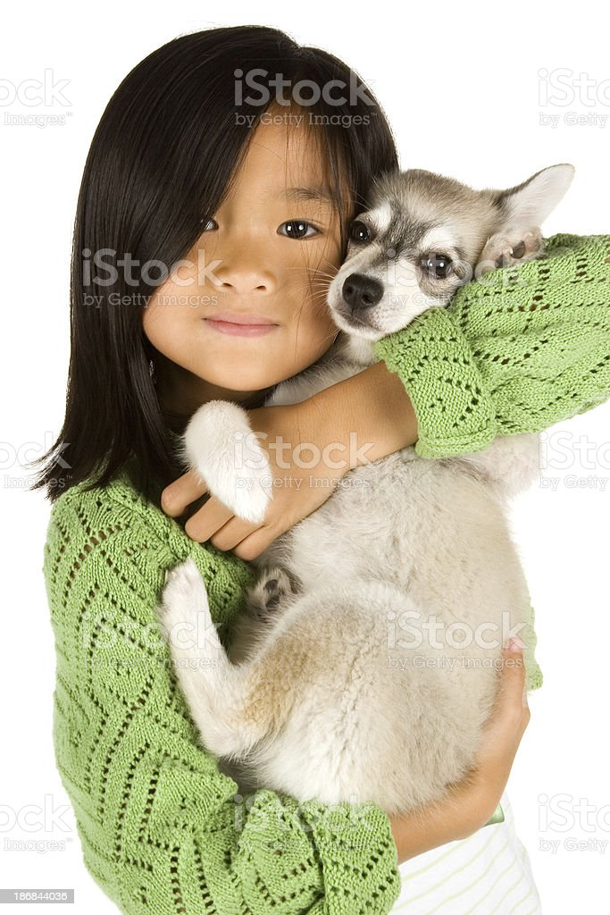 Asian girl holding her puppy royalty-free stock photo