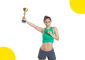 Asian Girl Holding Trophy Cup Smiling with candy lollipop on white background