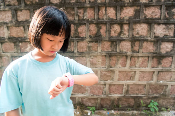 asian girl in alley with sun light beam in back in summer holiday stock photo