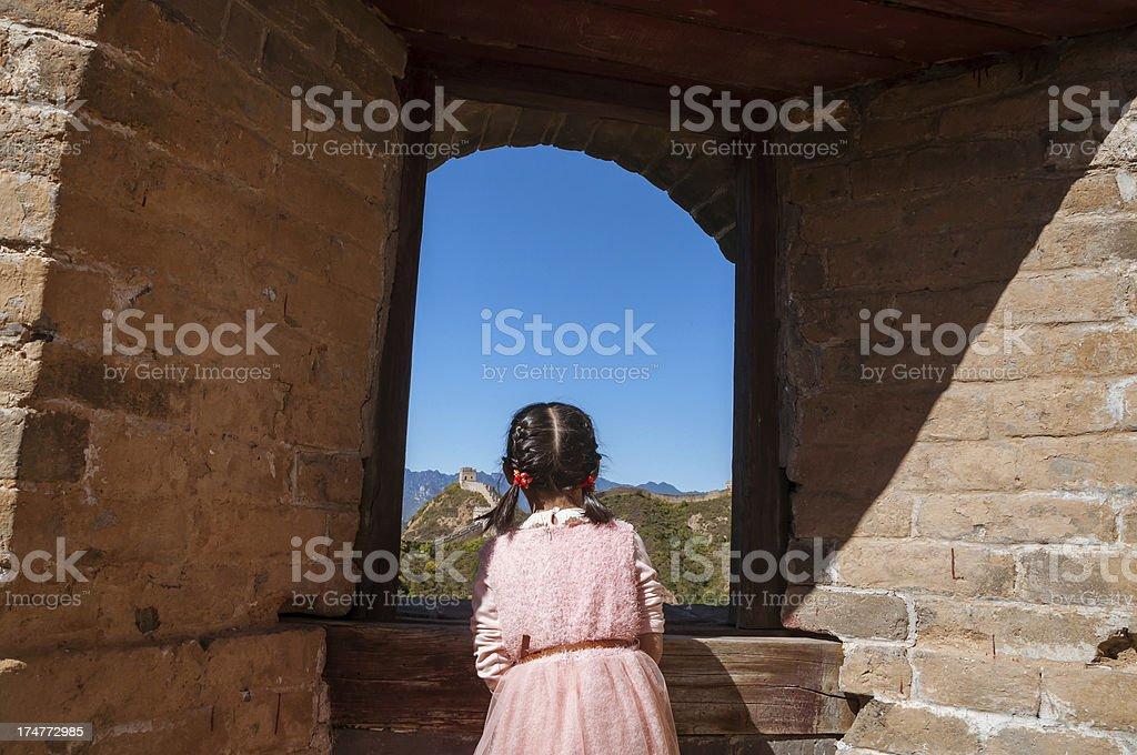 Asian girl in the Great Wall to look outside  window royalty-free stock photo