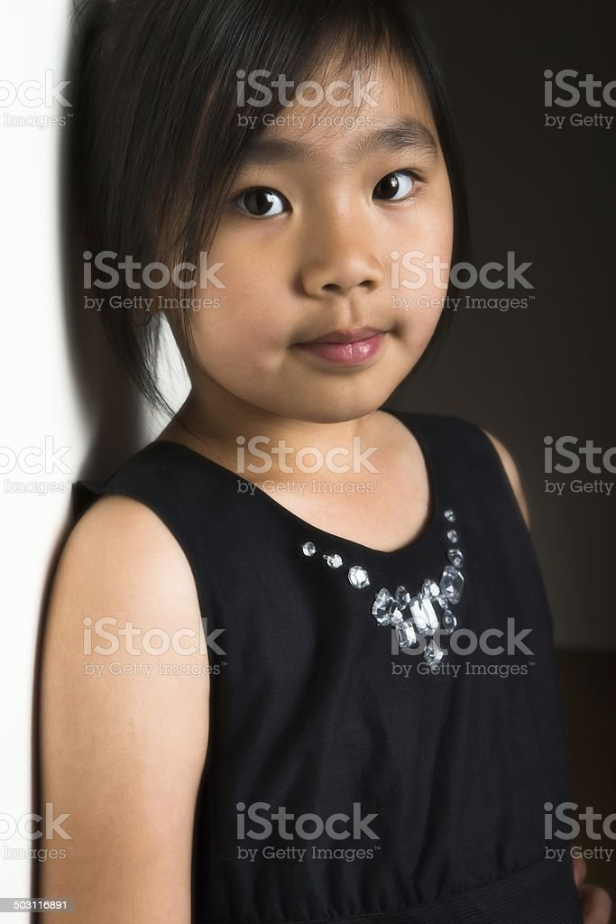 Asian girl leaning on wall. royalty-free stock photo