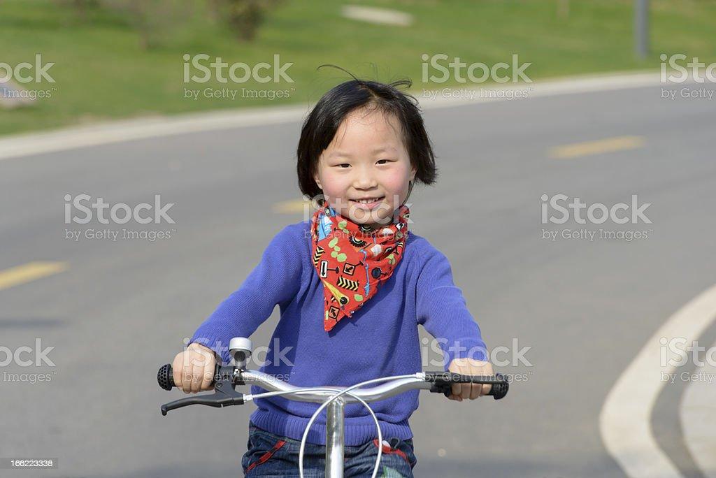 Asian girl Mimi, riding bicycle royalty-free stock photo